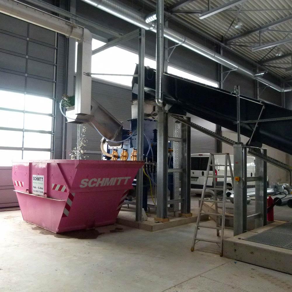 Feedstock pre-treatment and feeding equipment for a biogas reactor