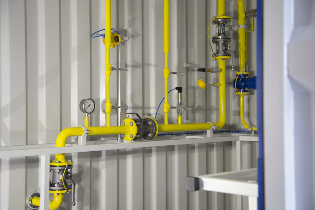 Gas grid connection unit uses 10 ft standard shipping containers.